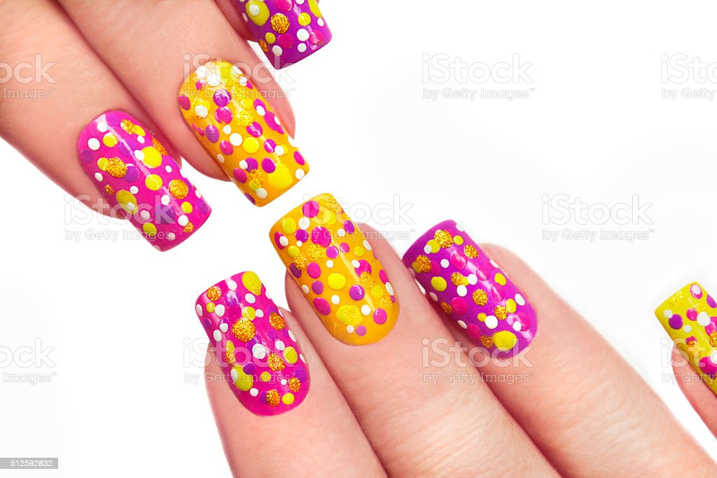 Multicolored manicure with dots. stock photo