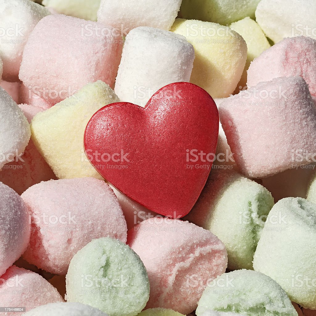 Multicolored Marshmallows with red candy heart royalty-free stock photo