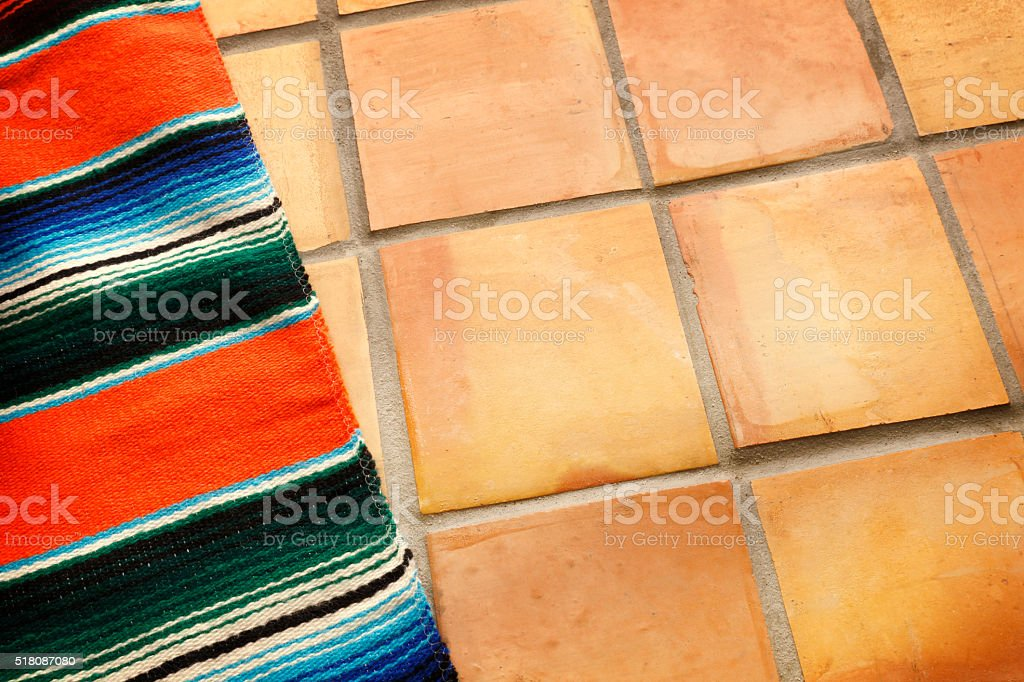 Multicolored Mexican Blanket On Saltillo Tiles stock photo