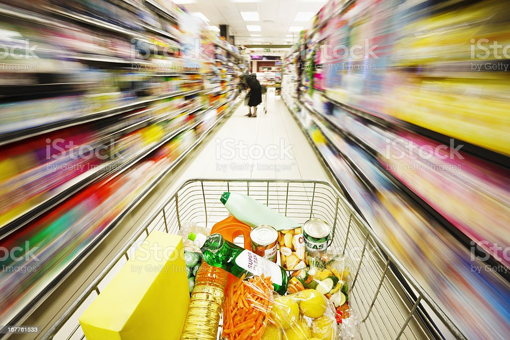 Multicolored motion blur streaks show speed of racing shopping cart royalty-free stock photo