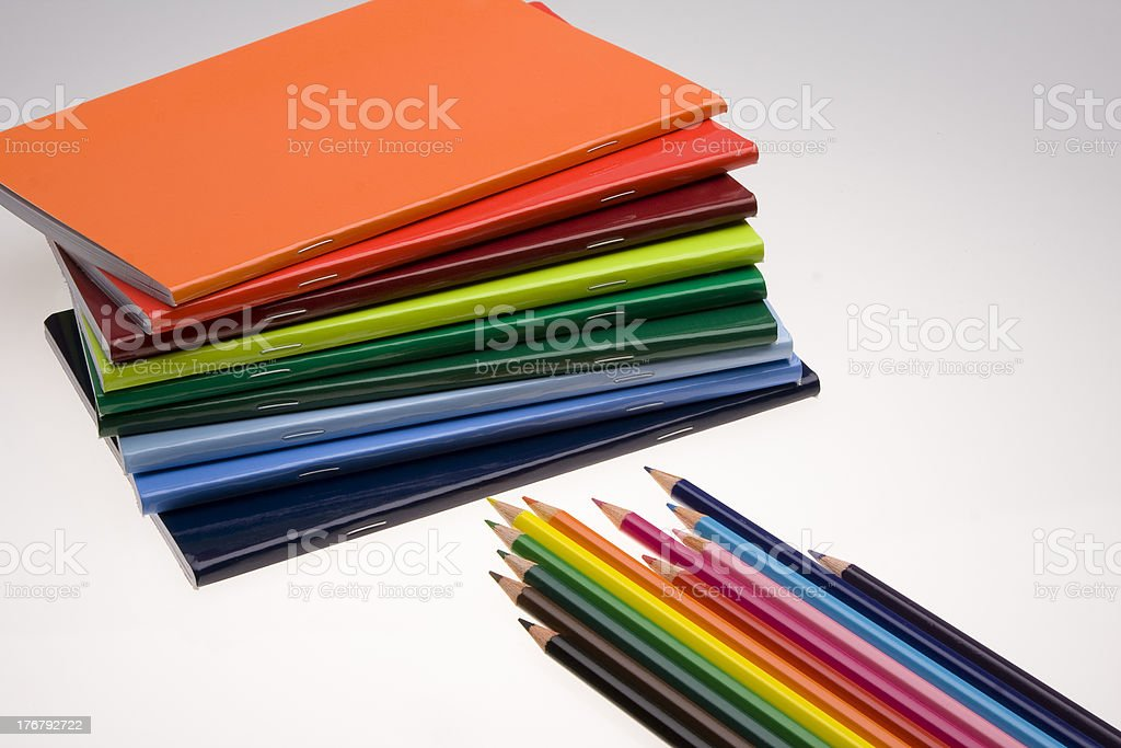 Multicolored Notebooks and pencils stock photo