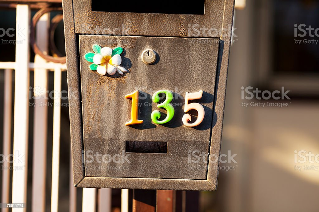Multicolored number 135 on letter box stock photo