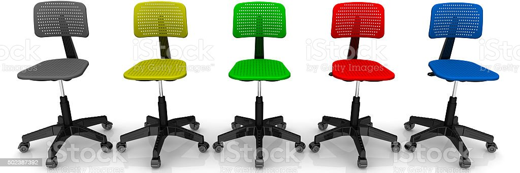Multicolored office chairs lined up in row stock photo
