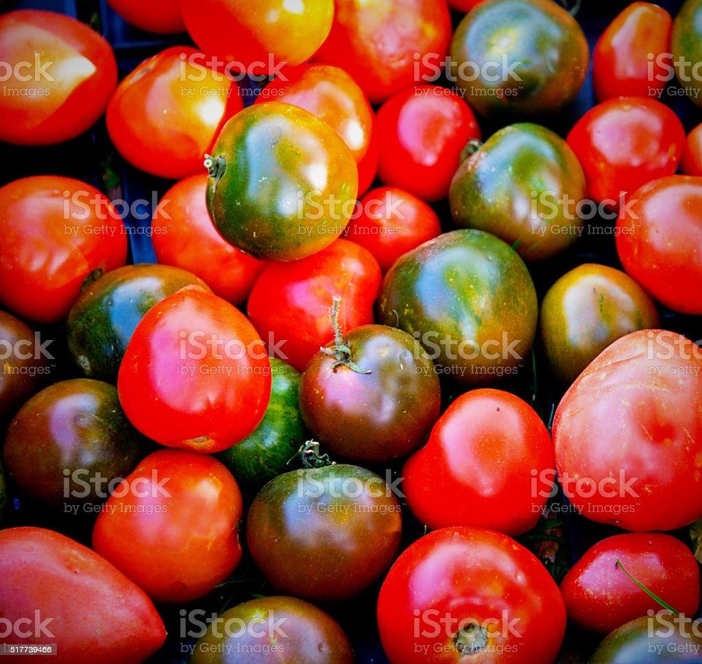 Multicolored  Organic Heirloom Tomatoes at Farmers Market. Closeup stock photo