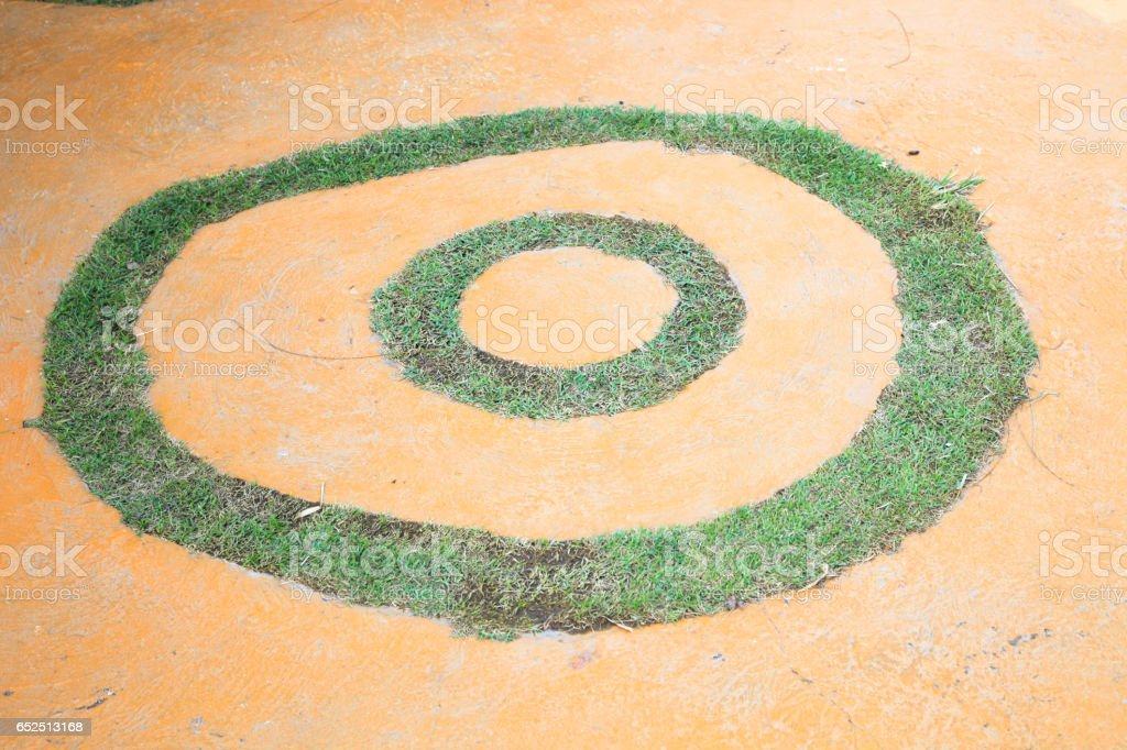 Multi-colored paint smeared randomly with green grass background stock photo