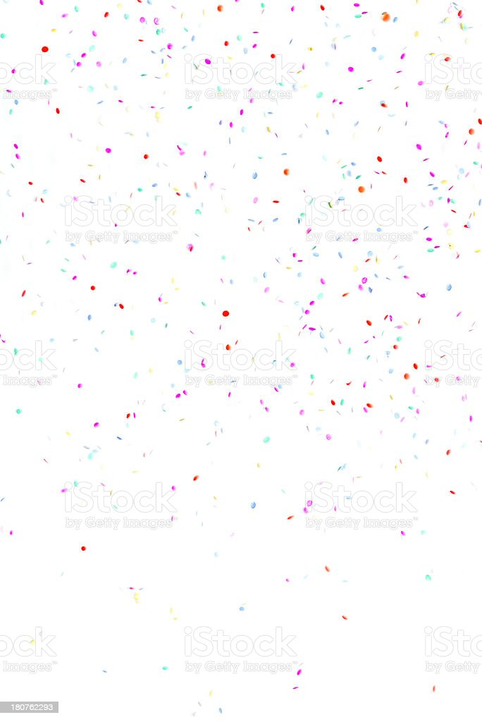 Multicolored paper circle confetti falling, isolated on white background stock photo