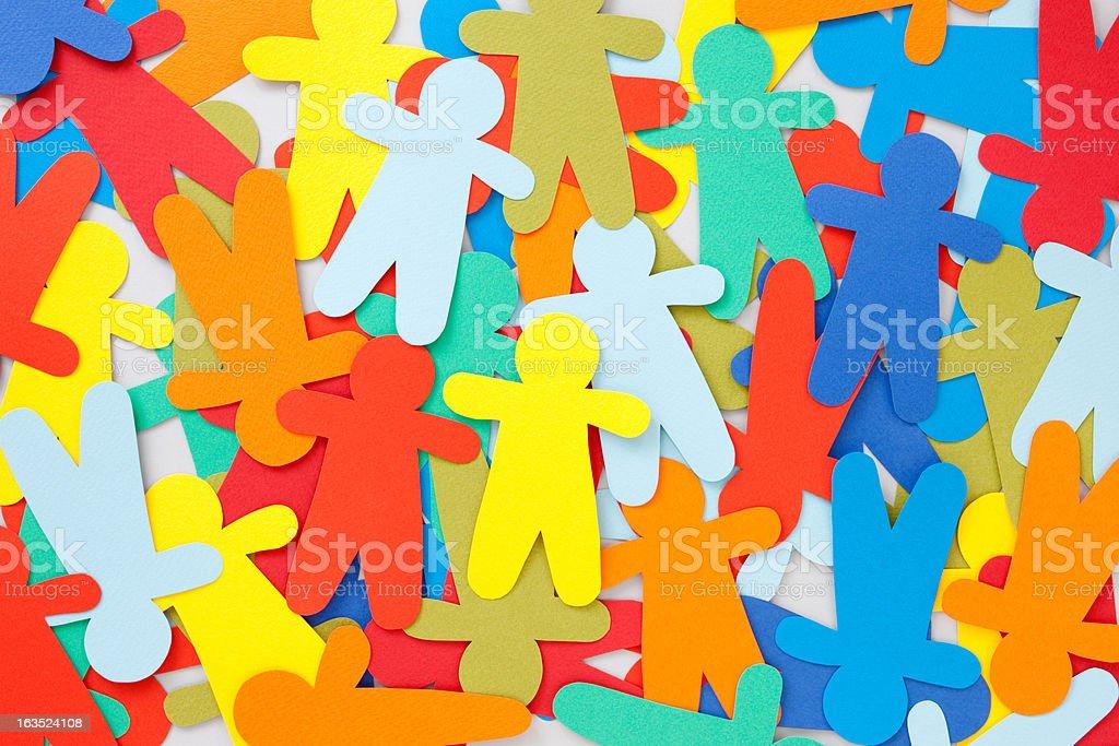 Multicolored paper men stock photo