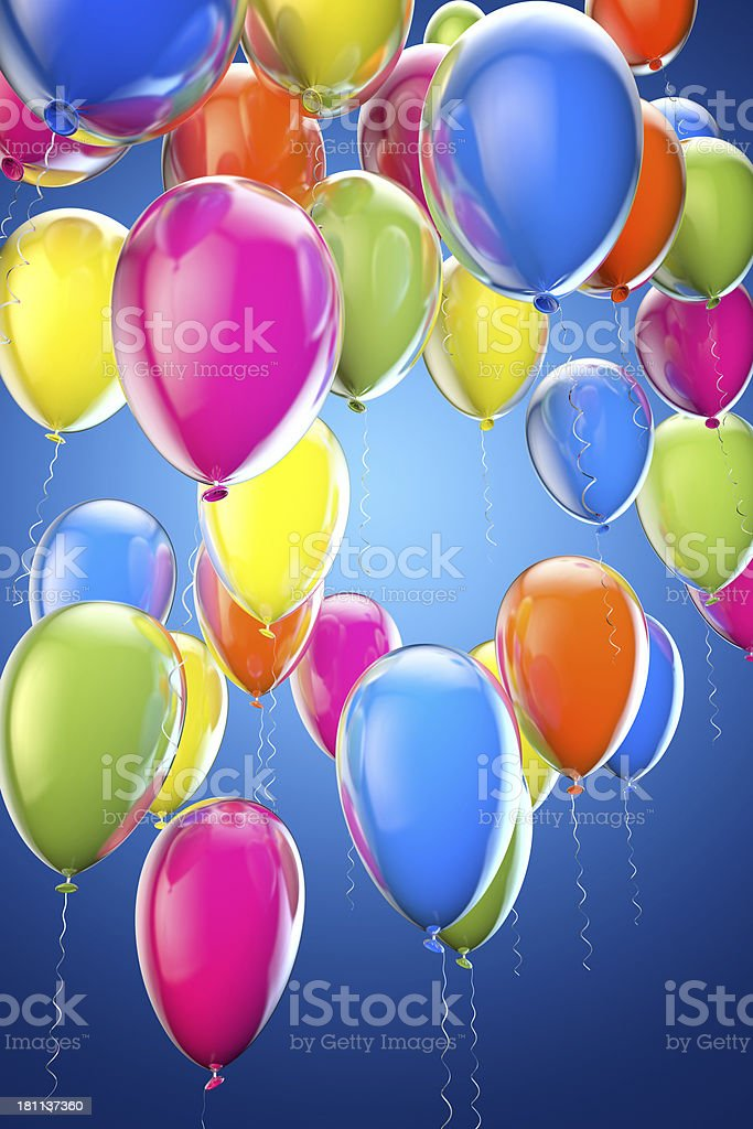 Multicolored party balloons on blue background royalty-free stock photo