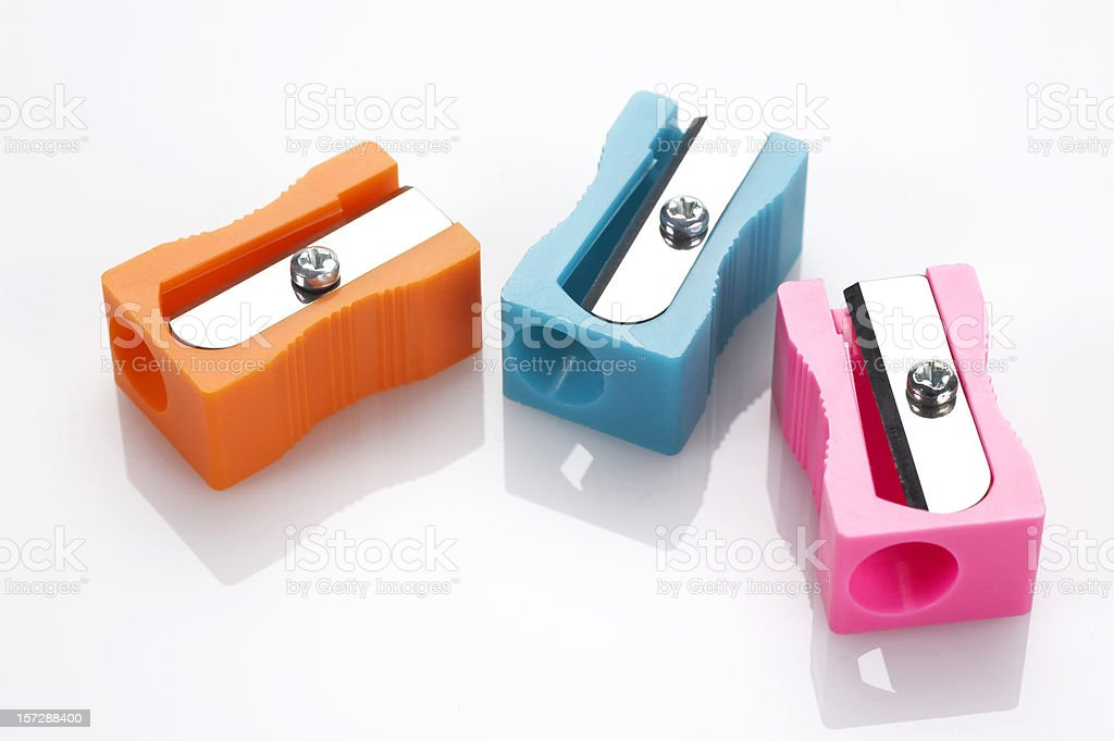 Multicolored pencil sharpeners stock photo