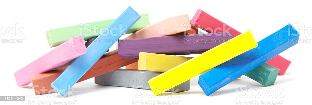 Multicolored pile of oil pastels isolated royalty-free stock photo