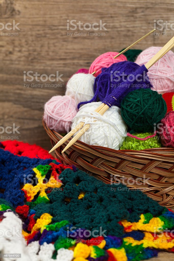 Multicolored plaid squares of crocheted stock photo