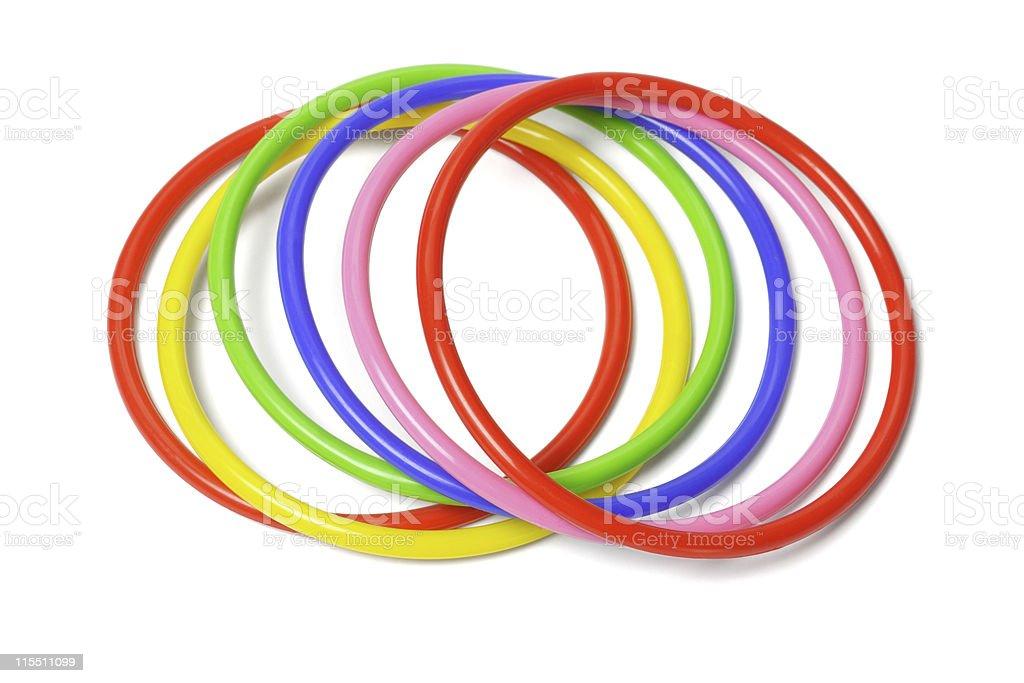 Multicolored plastic bangles on white background stock photo