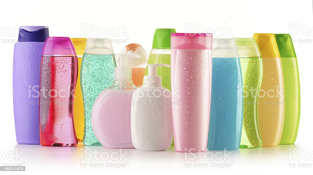 Multicolored plastic bottles of soap, shampoo and lotions stock photo