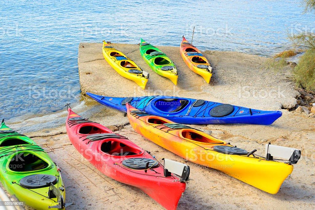 Multi-colored plastic kayaks stock photo