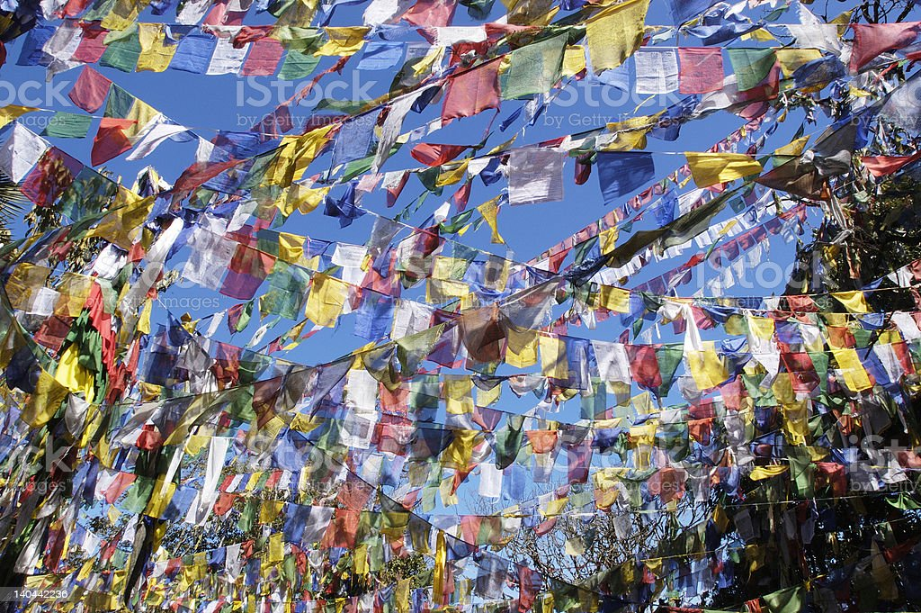 Multi-colored prayer flags fill the sky stock photo