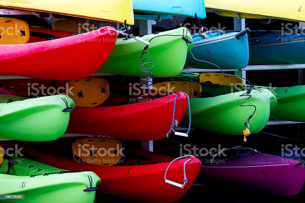 Multicolored rental kayaks stock photo