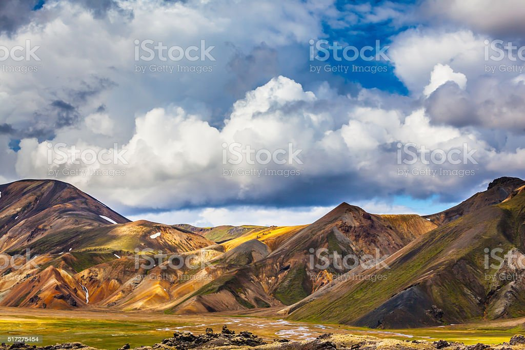 Multicolored rhyolite mountains of the July sun lit stock photo