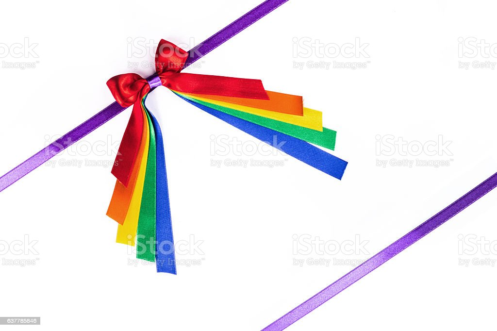 Multicolored ribbon bow on white stock photo