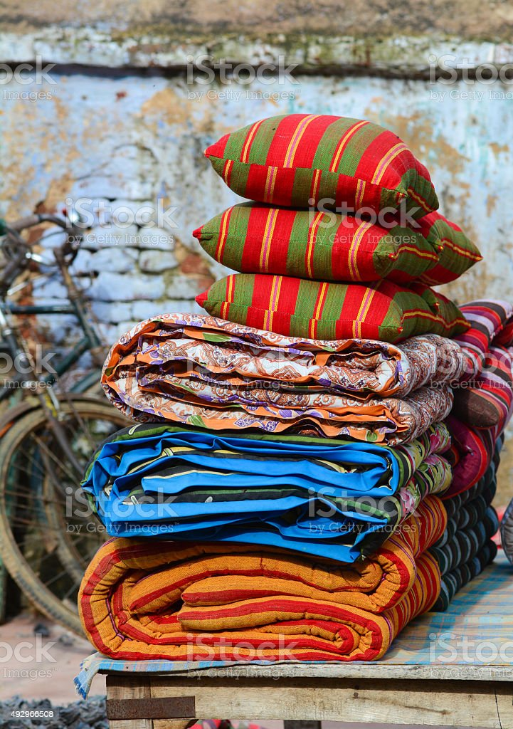 Multicolored rugs and cushions in outdoor stock photo