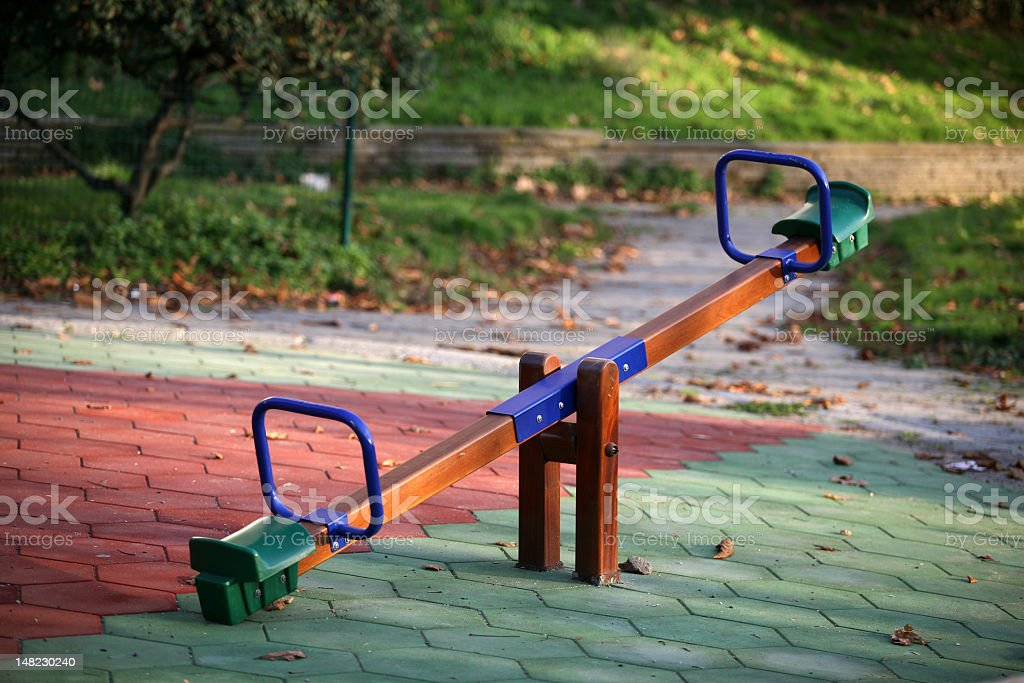 Multicolored seesaw outside in park stock photo