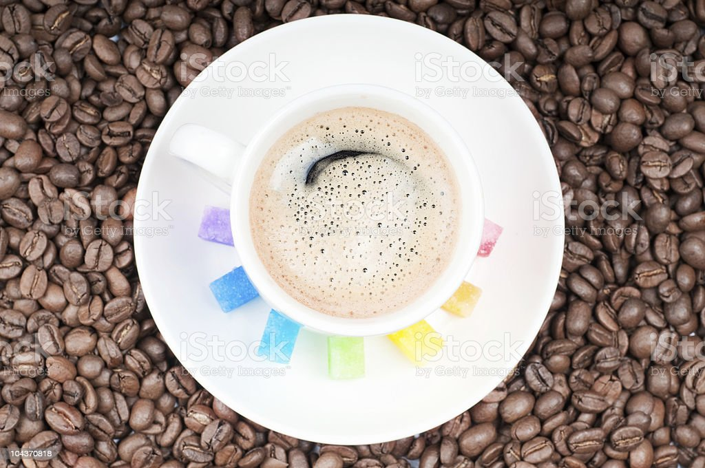 Multicolored slabs shugar and cup of coffee royalty-free stock photo