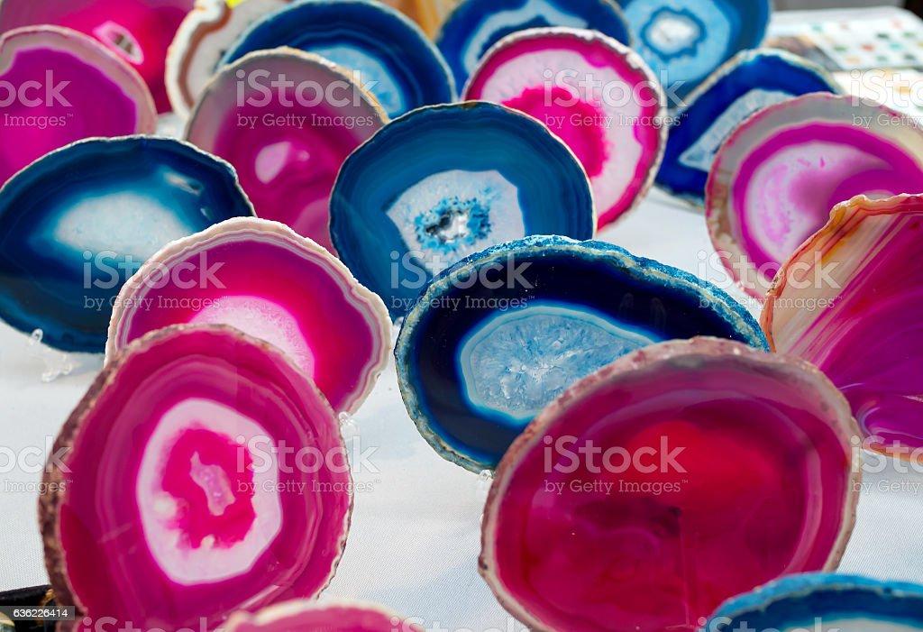 Multi-colored slices of semi-precious stones agate stone stock photo