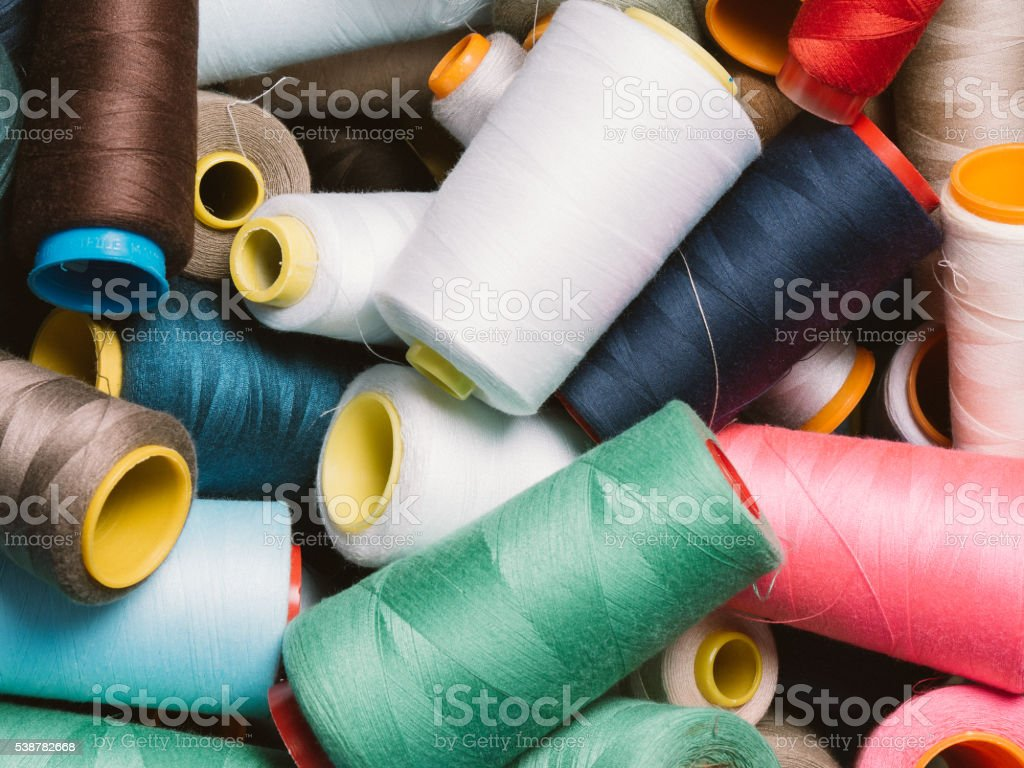 Multicolored spools of thread stock photo