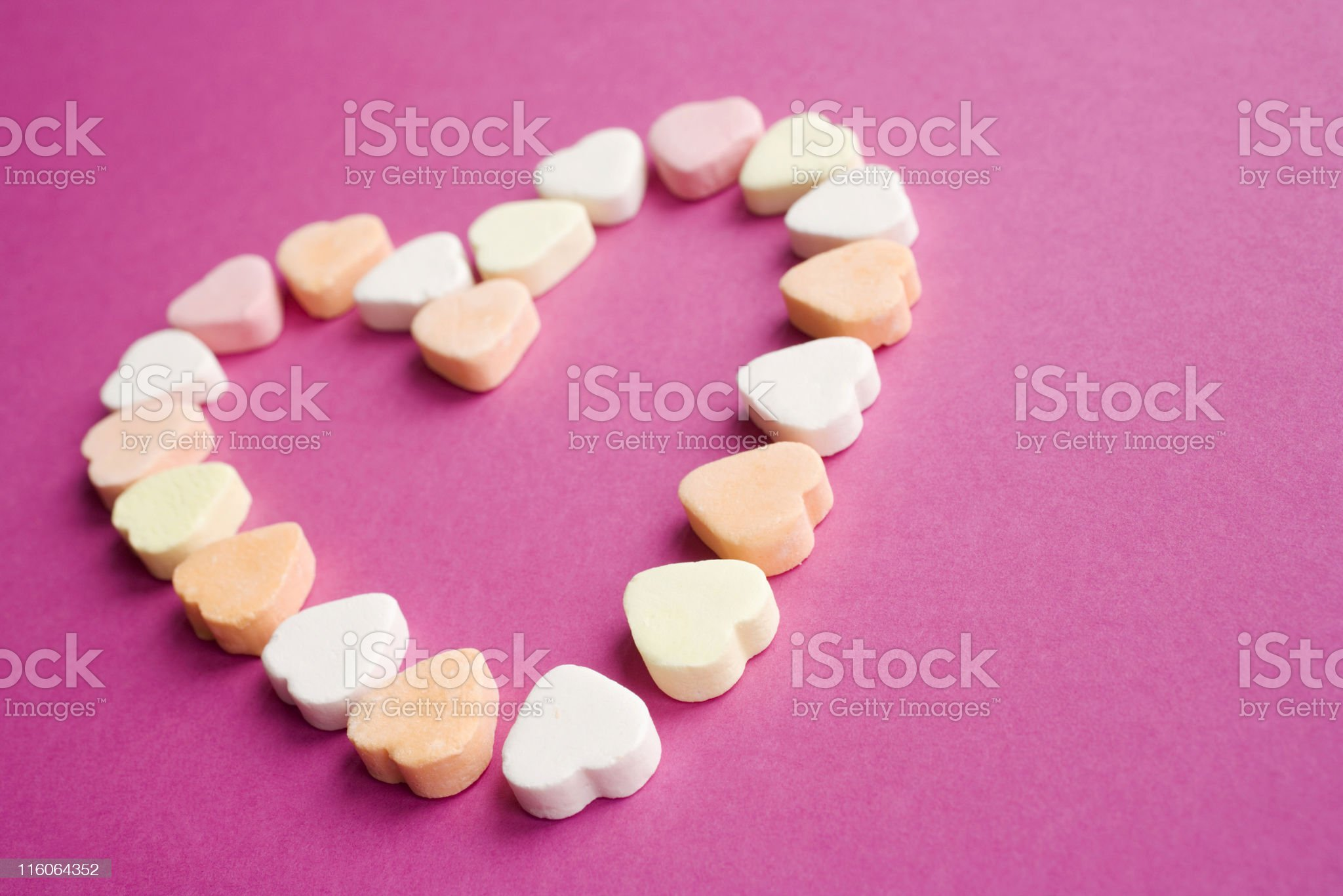 multicolored sugar candies arranged in the shape of a heart royalty-free stock photo