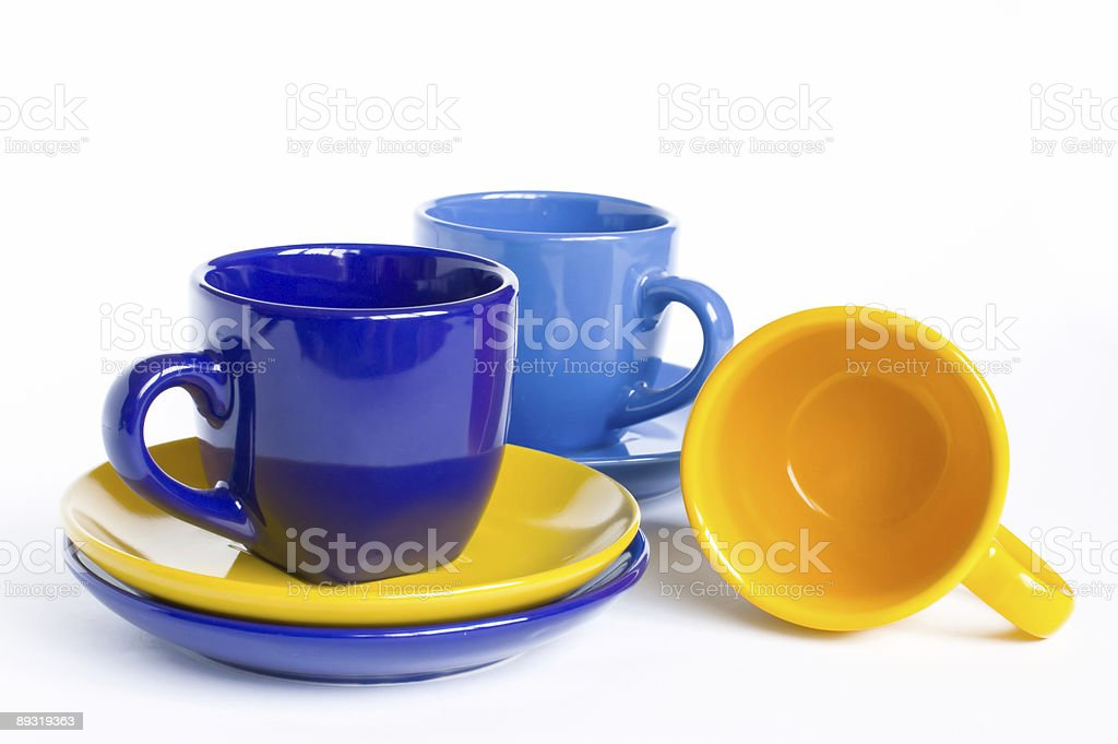Multicolored teacups and saucers stock photo