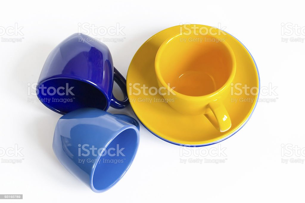 Multicolored teacups and sauсers stock photo