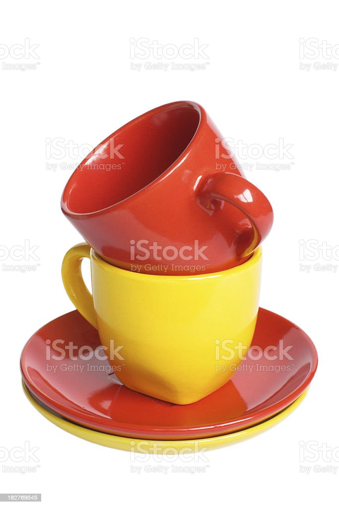 Multicolored teacups with saucers stock photo