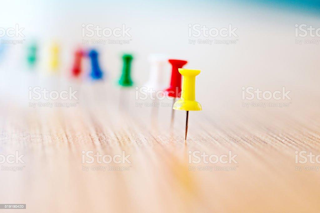 Multicolored thumbtack stock photo