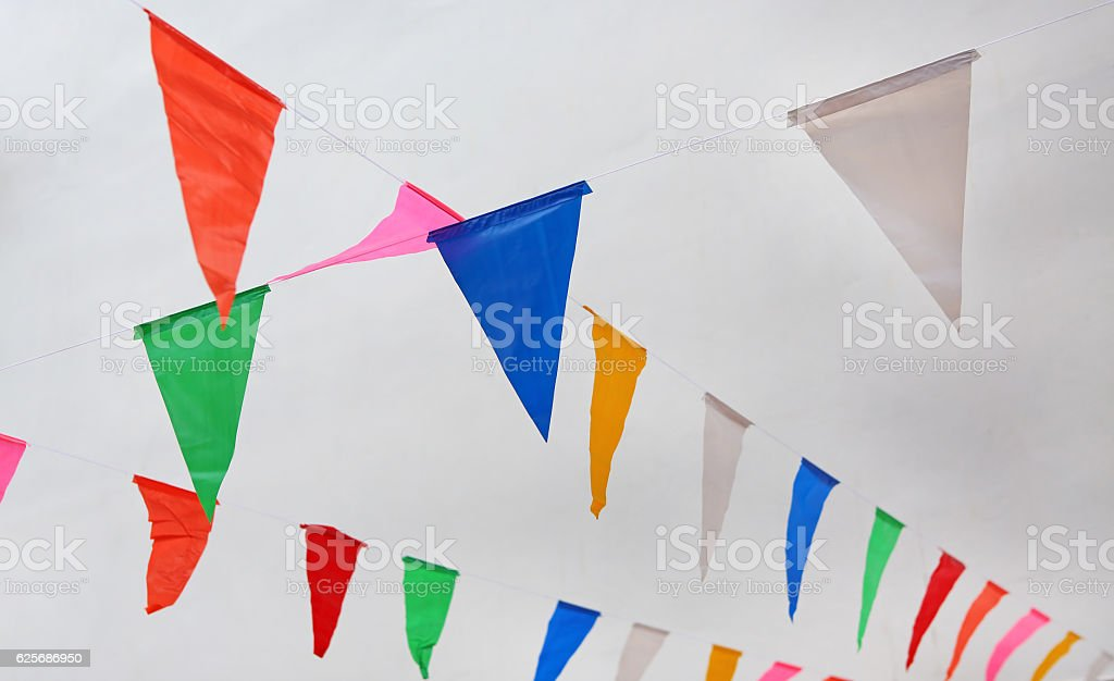 Multicolored Triangular Flags Hanging stock photo