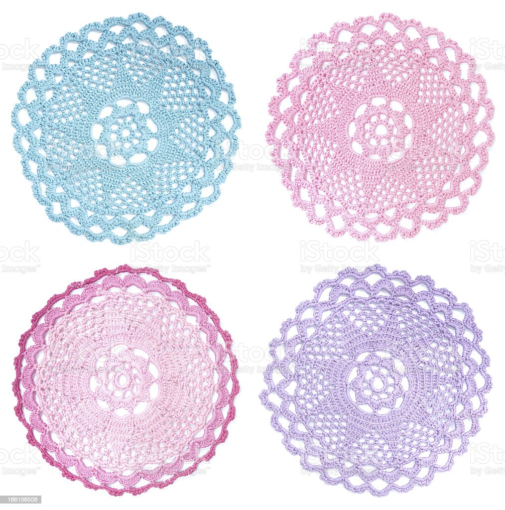 Multicolored vintage doilies stock photo
