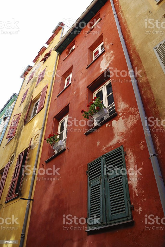 Multicolored walls of old-fashioned houses in Nice royalty-free stock photo