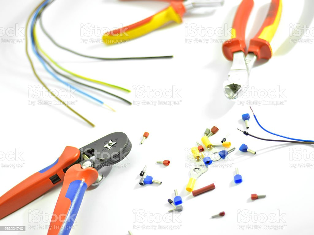 Multicolored Wires, Stripper Tools, Crimping Tools and Crimping Terminals on White stock photo