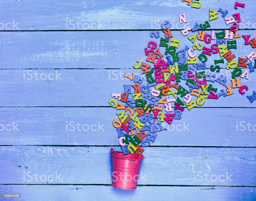 Multicolored wooden letters stock photo