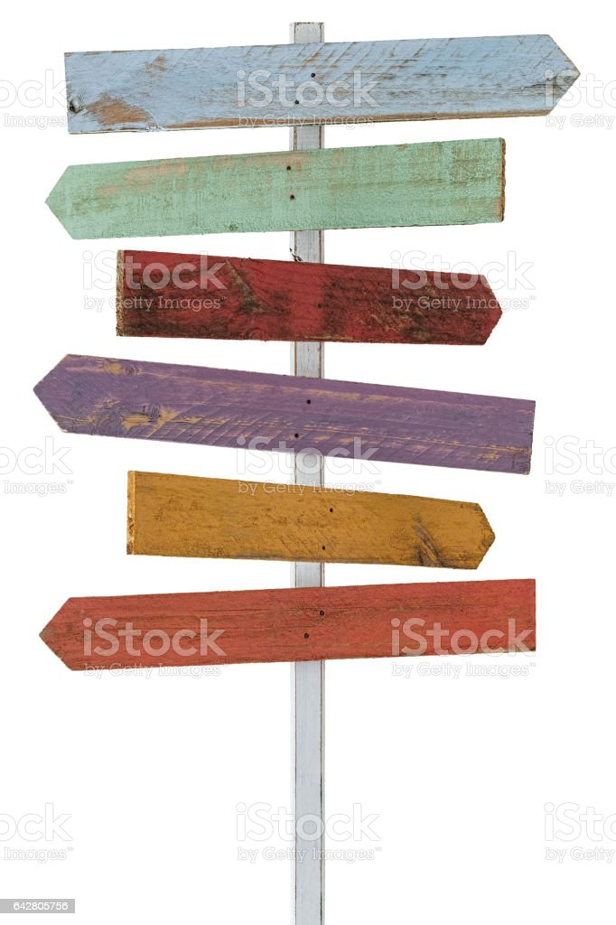 Multi-colored wooden sign post with six signs, isolated on white, clipping path included. stock photo
