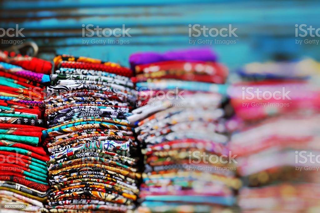 Multi-colors scarfs on the market stock photo