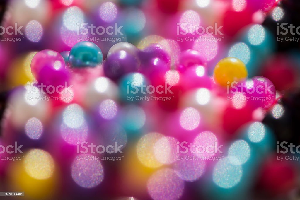 Multi-coloured beads background stock photo