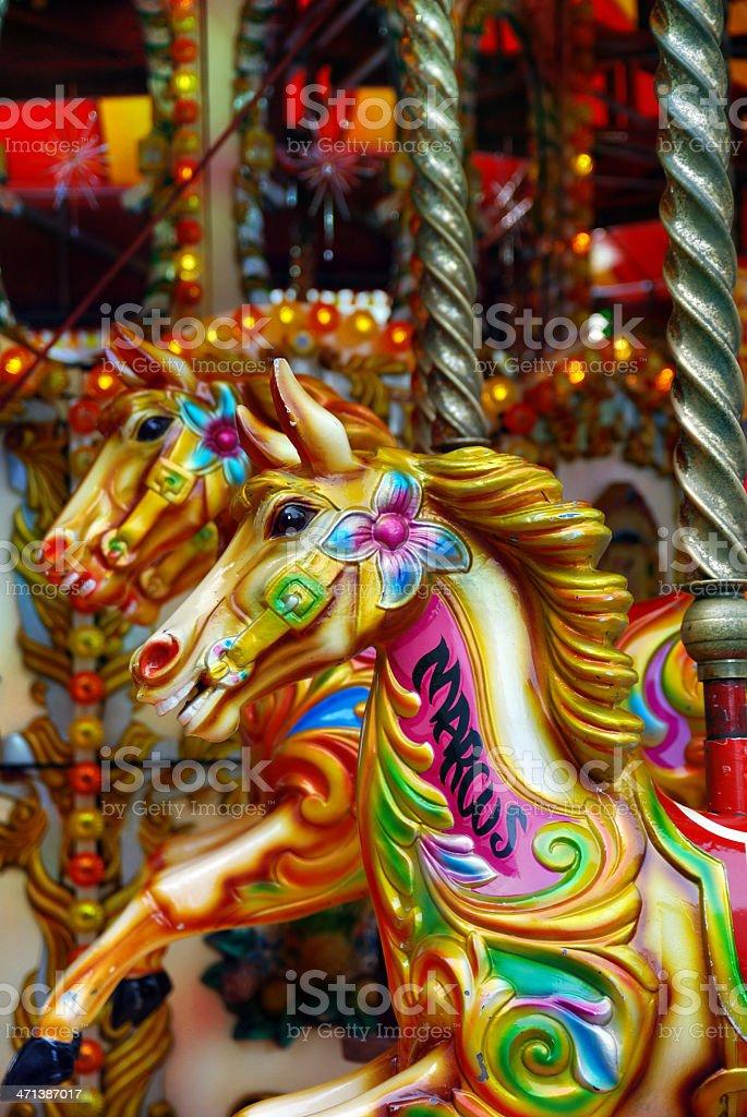 Multicoloured carousel horses stock photo