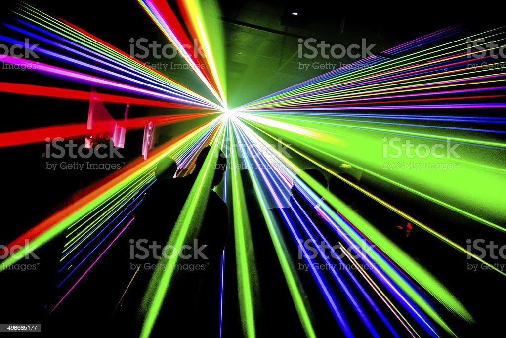 Multicoloured lasers in nightclub silhouette stock photo