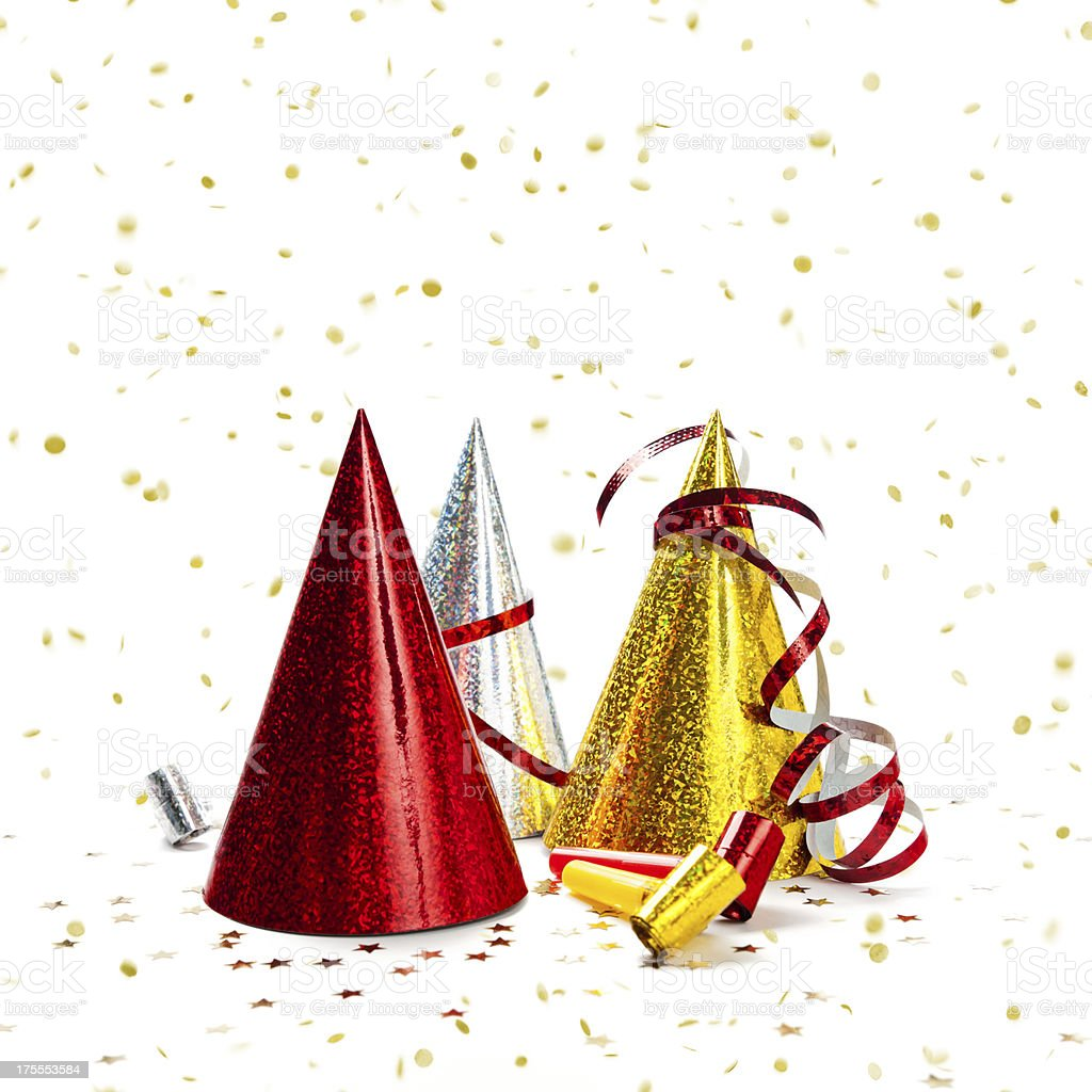 Multicoloured Party Hats with falling confetti, isolated on white background royalty-free stock photo