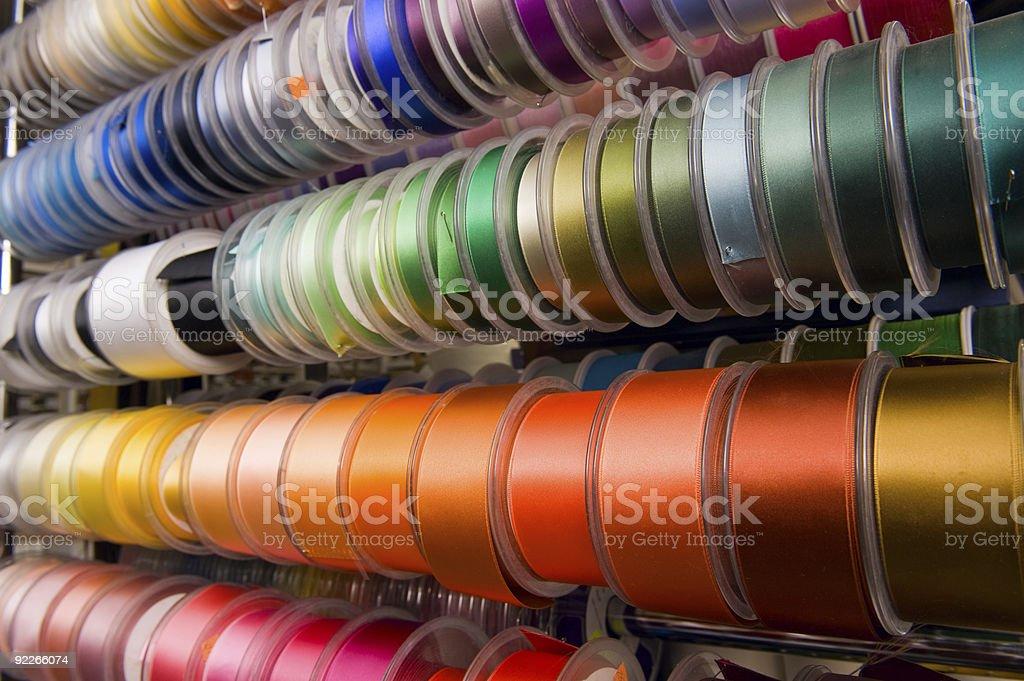 Multi-coloured ribbons on bobbins royalty-free stock photo