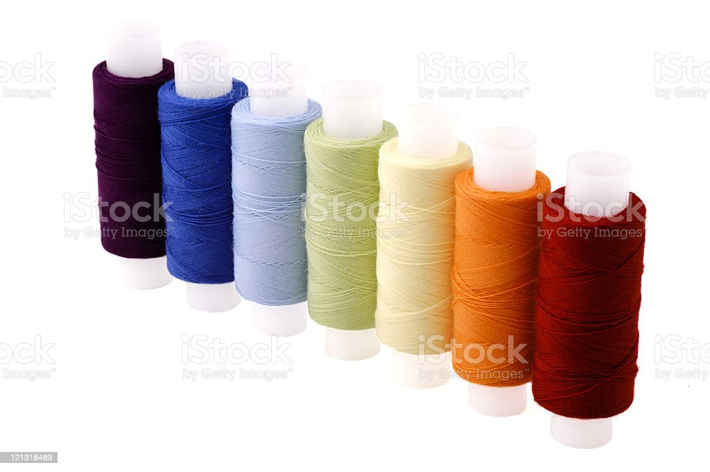 Multicoloured threads spools arranged in line as rainbow royalty-free stock photo