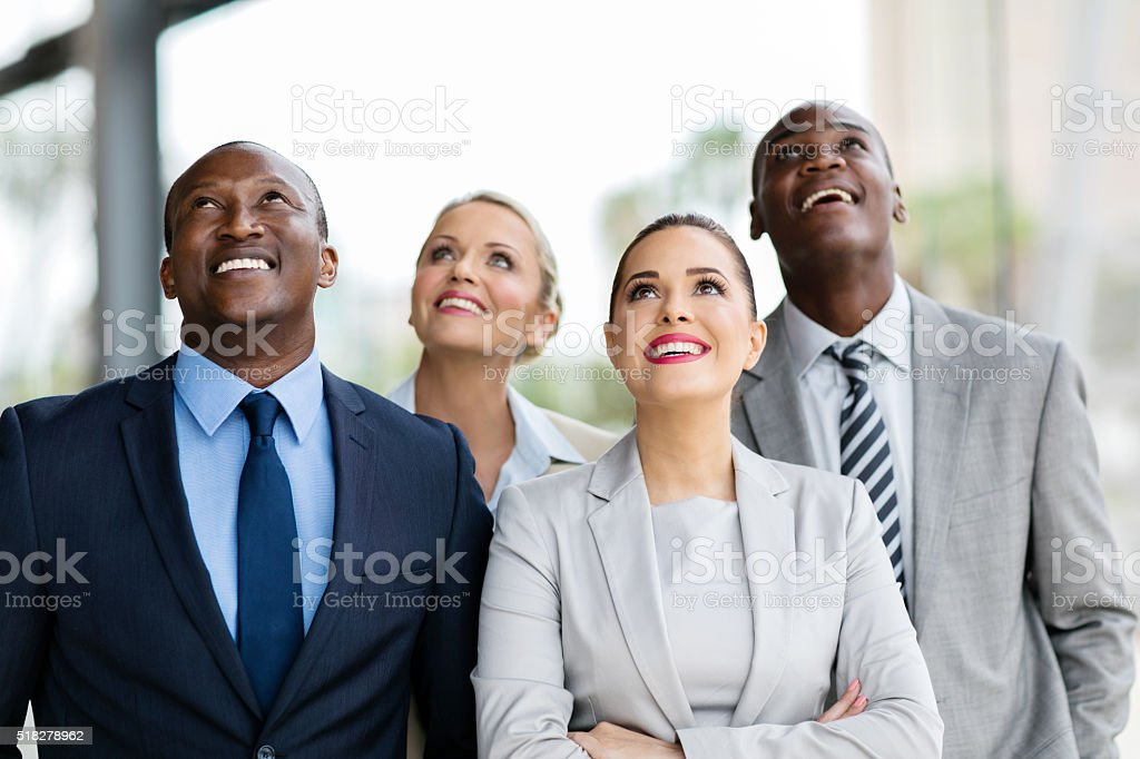 multicultural business group looking up stock photo