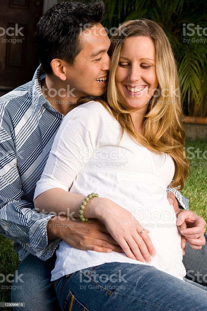 Multicultural couple having a baby stock photo