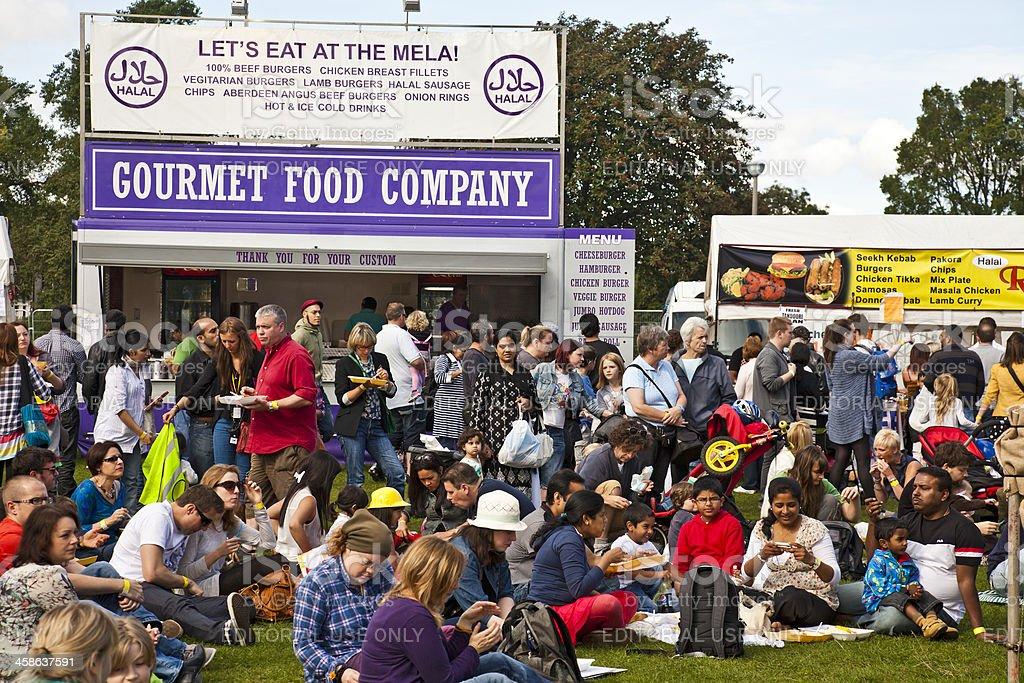 Multicultural crowd eating during Edinburgh Mela stock photo