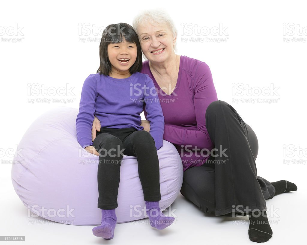 Multicultural Family: Granddaughter and Grandmother Smiling royalty-free stock photo