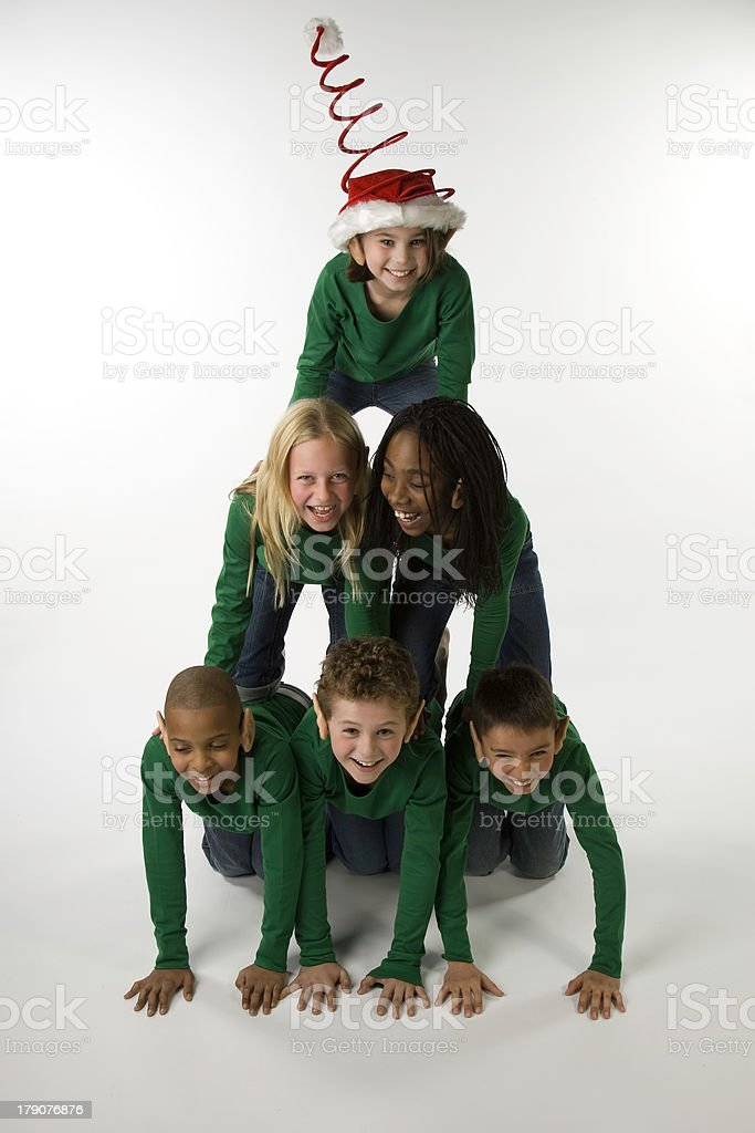 Multi-Cultural Pyramid of Christmas Elves stock photo